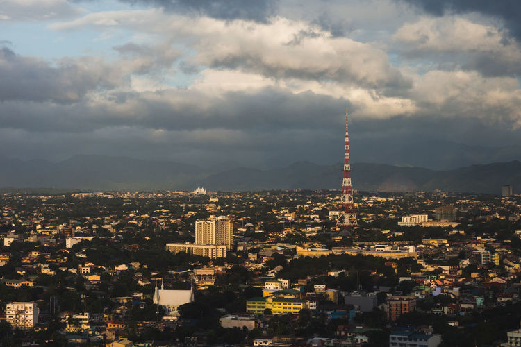 Quezon City Architecture Built Structure City Cityscape Coulds Day Golden Hour No People Outdoors Sky Sunset Tower