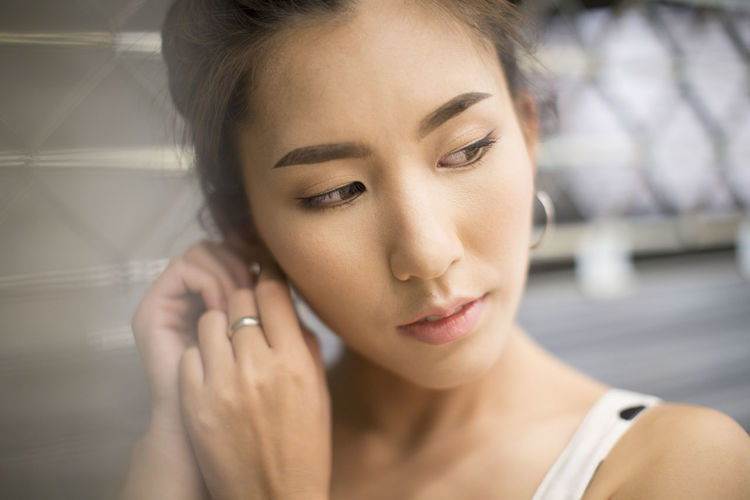 Beautiful Asian girl Headshot Portrait Beauty Beautiful Woman Young Adult One Person Young Women Adult Focus On Foreground Close-up Women Looking Front View Make-up Indoors  Looking Down Smiling Real People Hairstyle Contemplation