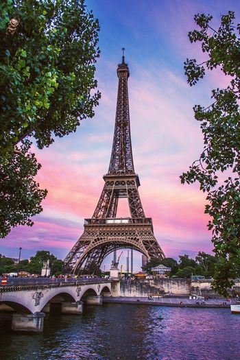 The captivating beauty of The Iron Lady! It's hard to imagine Paris without the Eiffel Tower, but did you know that this iconic figure was originally built as a temporary structure for the 1889 World fair in Paris and was only meant to last through the exposition period. Lucky for us it was never demolished! Paris Eiffel Tower Europe Beautiful Fujifilm_xseries Travel Photography Amazing View Architecture French France Bridge Seine River X-Pro1 Sunset_captures Travel Destinations The Architect - 2017 EyeEm Awards