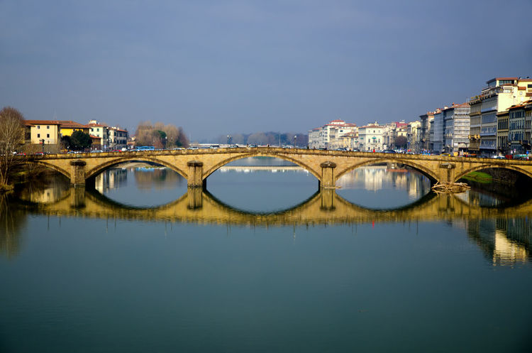 Bridge in Florence, Italy. Antique Arch Architecture Architecture Bridge - Man Made Structure Building Exterior Built Structure City Cityscape Clear Sky Connection Day Famous Place Lull Mirror Mirror Image Outdoors Reflection Reflection River Sunny Tranquil Scene Tranquility Travel Destinations Water
