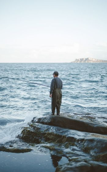 Sea Water Rear View Horizon Over Water Nature Full Length One Person Beauty In Nature Scenics Tranquility Tranquil Scene Real People Men Sky Standing Mature Adult One Man Only Outdoors Day Ankle Deep In Water