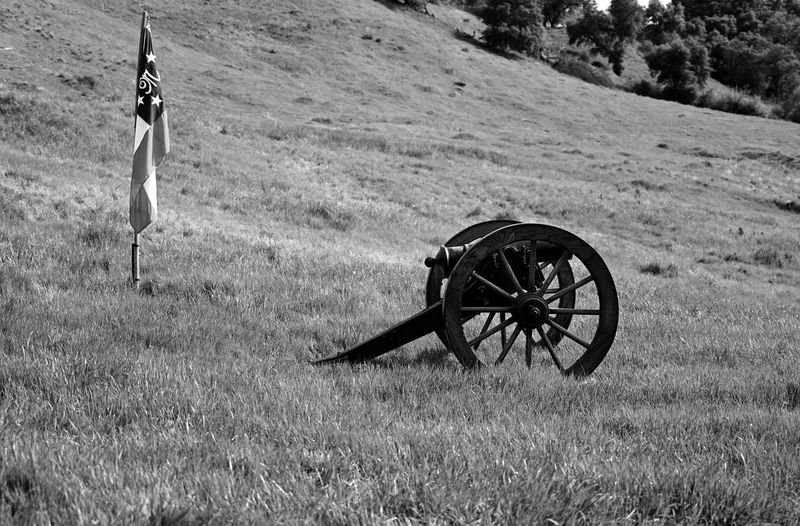 Civil war reenactment cannon Open Field Non-urban Scene Focus On Foreground Tranquil Scene Patriotism Tranquility Flag No People Outdoors Day Plant Wheel Field Nature Transportation Land Grass Knights Ferry USA California