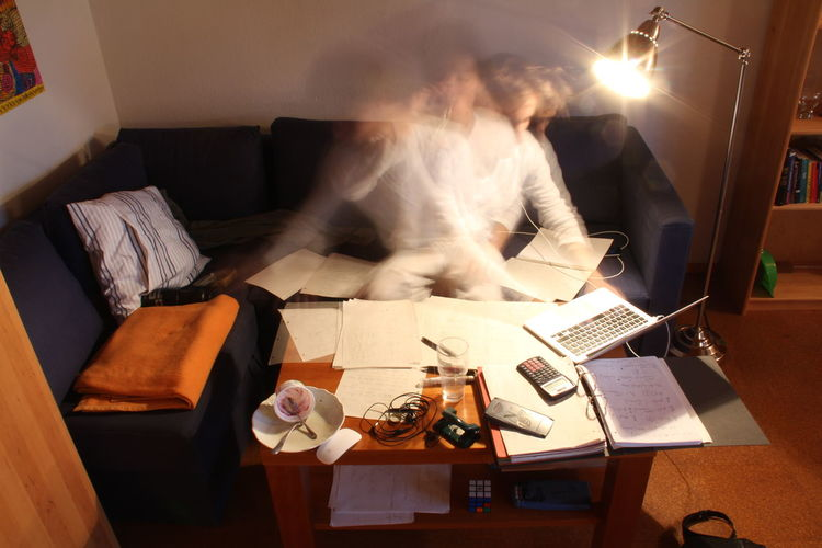 Blurred motion of student studying at home