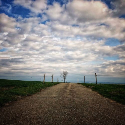 The road Cloud - Sky Sky Land Nature Beauty In Nature Scenics - Nature Field Day Tranquil Scene Tranquility Landscape Horizon