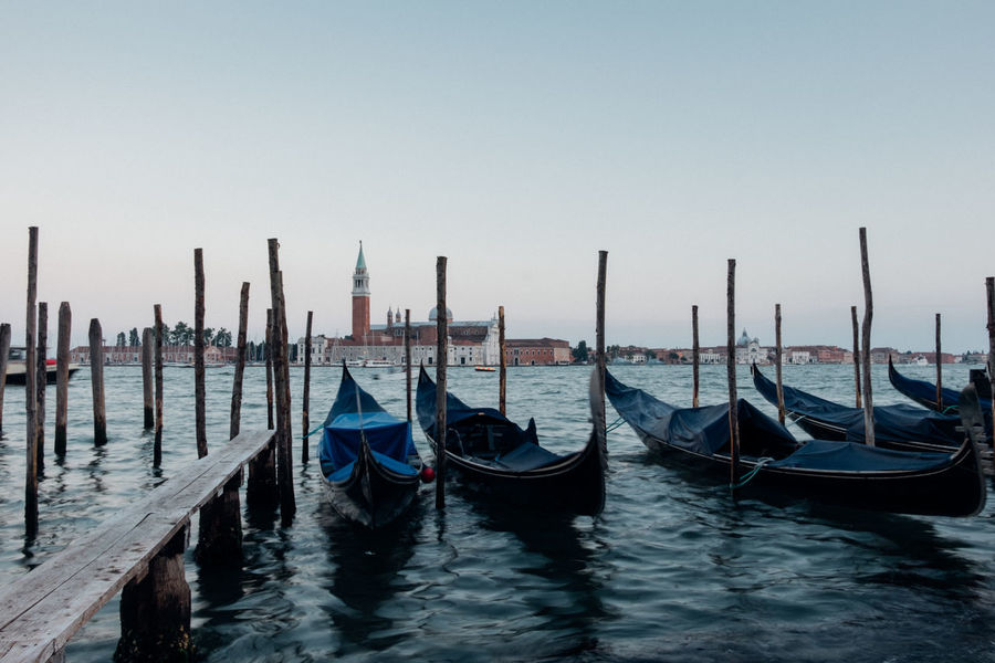 Venice, Italy Boat Day Gondola Group Of Objects Harbor In A Row Mode Of Transport Nature Nautical Vessel No People Ocean Outdoors Rippled Sky Sunset Tourism Tranquil Scene Tranquility Travel Travel Destinations Venezia Venice Venice, Italy Wanderlust Water