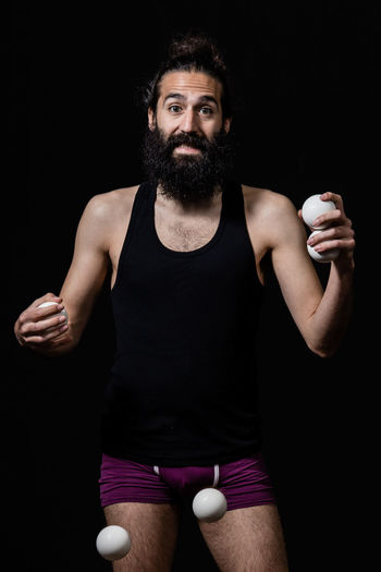 Juggler having funt at the circus Adult Black Background Circus Happy Juggle Man Show Stage Acrobat Balls Beard Black Background Different Entertainment Juggler Juggling One Man Only One Person People Performance person Portrait Real People Studio Photography Studio Shot