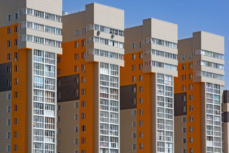 New multi-storey buildings in a row. concept of housing construction for newcomers
