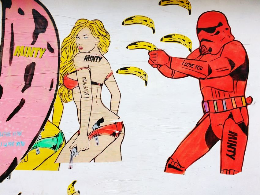 Street Photography Adult People Painted Image Streetphotography Forgottenspaces Outdoors Aerosol Urbanartculture Urbanarts Textures And Surfaces Urban Landscape Wheatpaste Pasted On The Wall Signofthetimes Wall - Building Feature Urbanphotography Urbanartphotography Graffiti Street Art Bananas Red Lines, Shapes And Curves Stormtrooper PinUpGirl