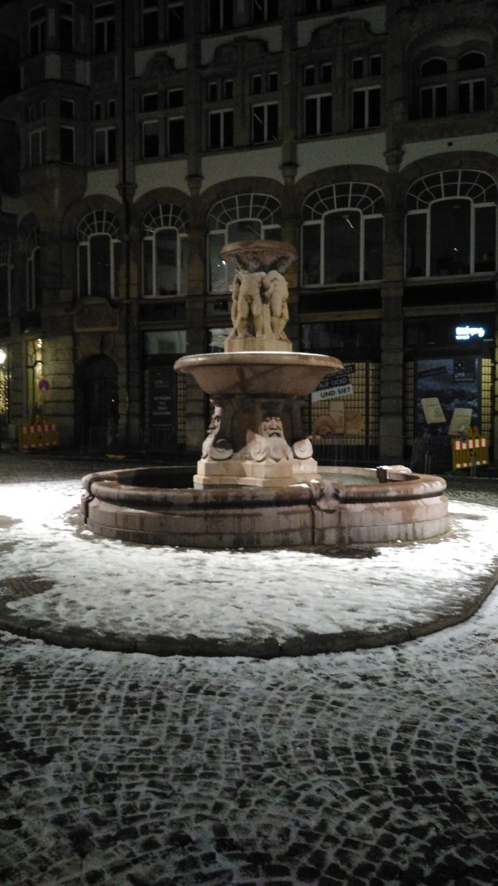 statue, sculpture, fountain, art and craft, architecture, building exterior, built structure, travel destinations, waterfront, winter, outdoors, illuminated, no people, night, cold temperature, water, city
