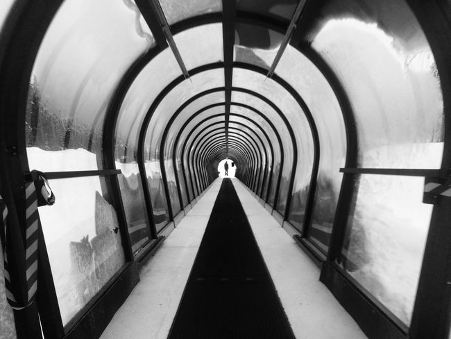 Magic carpet ride to go Snowboarding 🏂 ❄️! Arch The Way Forward Indoors  Snowboard Mountain Fun Tunnel Blackandwhite EyeEm Best Shots EyeEmNewHere Conveyor Belt IPhoneography Iphone5s Miles Away Minimalist Architecture Welcome To Black