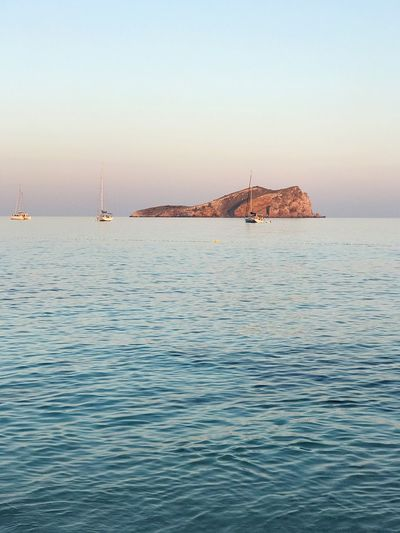 EyeEm Selects Sea Water Tranquility Scenics Waterfront No People Beauty In Nature Nature Tranquil Scene Rippled Outdoors Transportation Sky Nautical Vessel Horizon Over Water Clear Sky Sailboat Day Mast Beauty In Nature Clear Sky Ibiza Tranquility Cala Conta