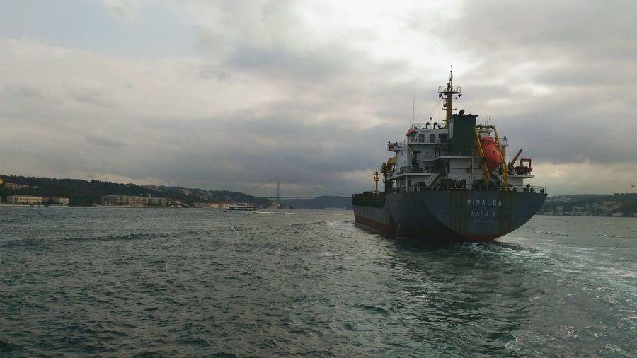 Ship transing Bosphorus. Ships⚓️⛵️🚢 Bosphorus Bosphorus Bridge Grey Ship Dark Clouds First Eyeem Photo