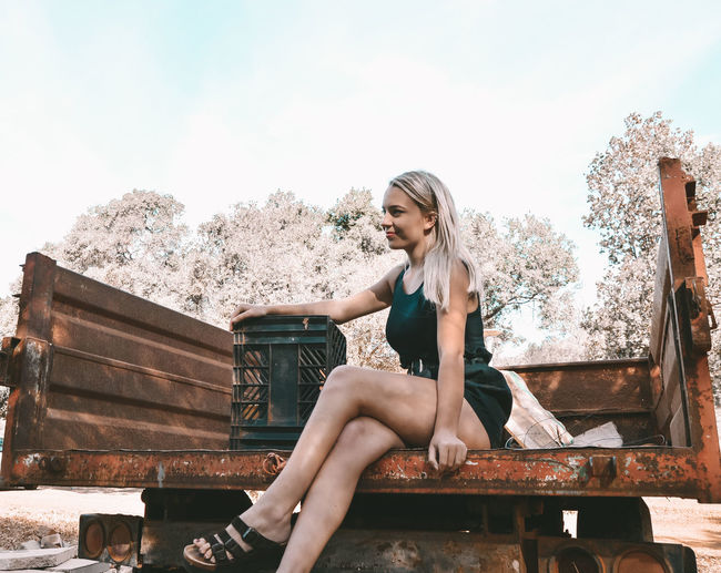 Woman sitting on truck