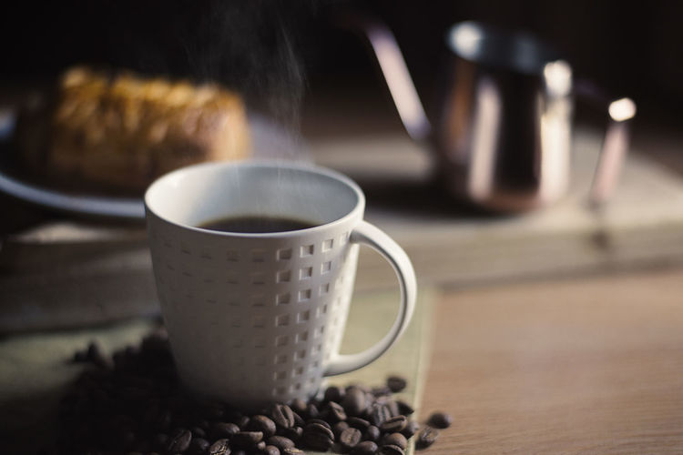 Balck coffee and croissant bread breakfast Breakfast Coffee Coffee Time Kettle Pouring Kettle Steam Wood Afternoon Tea Aroma Bread Brunch Cafe Close-up Coffee - Drink Coffee Beans Coffee Break Coffee Cup Croissant Dark Background Mug Refreshment Retro Styled Swan Neck Kettle Table Tea
