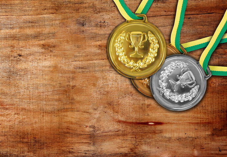 High Angle View Of Medal On Table