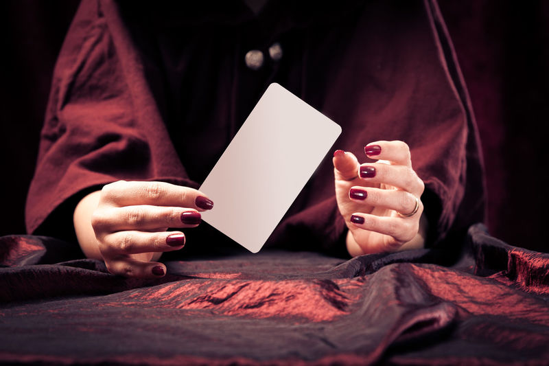 Psychic reading your future Copy Space Fortune Telling Tarot Witchcraft  Blank Brunette Cards Charlatan Forecast Fortune Teller Future Human Hand Indoors  Luck Magic Magick Medium One Person People Psychic Psychic Medium Tarot Cards Witch Women Young Adult