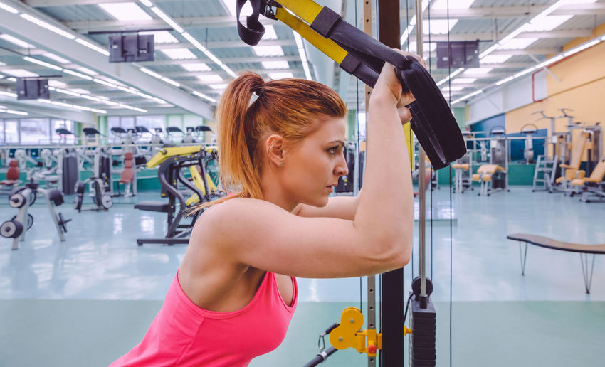 Woman exercising with resistance band at gym