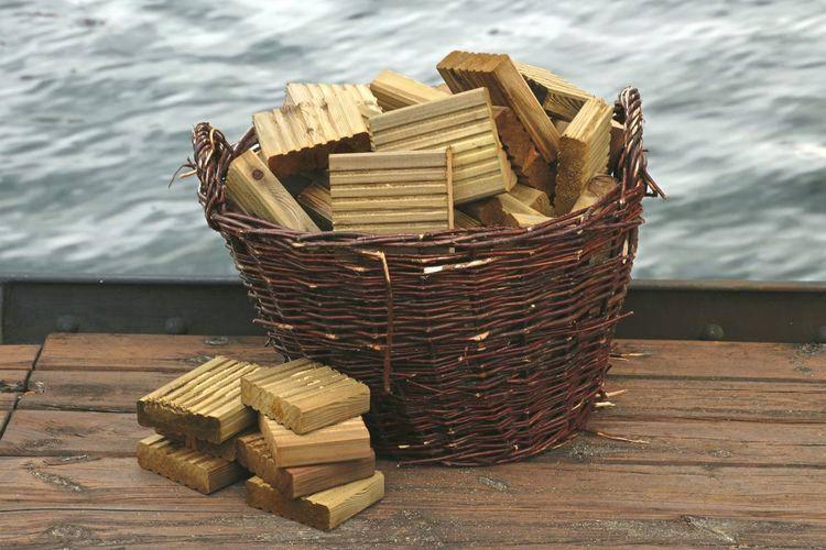 Wooden Blocks In Basket On Pier Over Lake