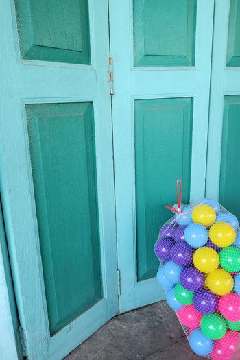 Blue Color Bright Colors Geen Color Ball Celebration Childhood Cheerful Joyful Close-up Day Door Doorway Multi Colored No People Outdoors Toy
