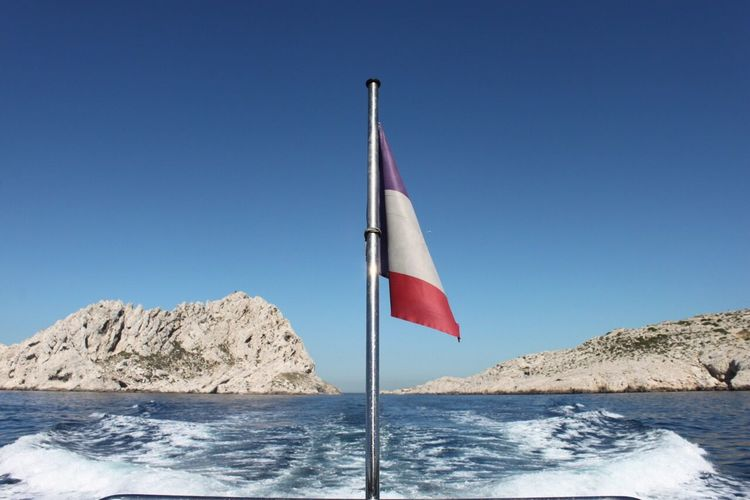 Clear Sky Copy Space Flag Blue Patriotism Water No People Nature Outdoors Day Beauty In Nature Sea Mountain Scenics Sky EyeEm Nature Lover EyeEm Best Shots - Nature New Talents On EyeEm Marseille Calanques  Stream - Flowing Water Beauty In Nature France