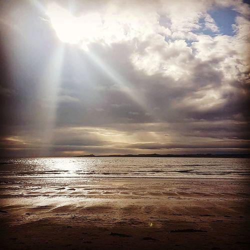 Sea Sunbeam Water Beach Cloud - Sky Sun Dramatic Sky Sunlight Horizon Over Water Sky Tranquil Scene Sand No People Rippled Tranquility