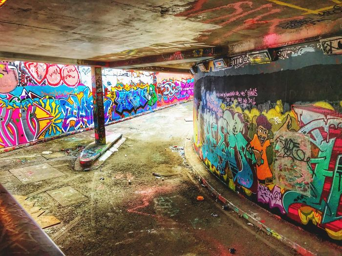 Graffiti Street Art Multi Colored Art And Craft Spray Paint Indoors  Tunnel No People Architecture Day