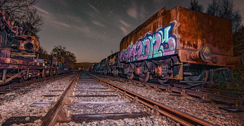 Rusting Retirement Graffiti Nightphotography Red Rust Architecture Carriage Gravel Long Exposure Night No People Outdoors Rail Transportation Railroad Track Railway Carriages Railway Track Rusty, Old, Nail, Rust, Background, Isolated, Construction, Metal, Iron, Object, Tool, Vintage, Steel, Metallic, Macro, Dirty, Head, Texture, White, Industry, Design, Screw, Rivet, Mechanic, Industrial, Collection, Build, Work, Hardware, Stainless, Bolt,  Sky Transportation Vandalism