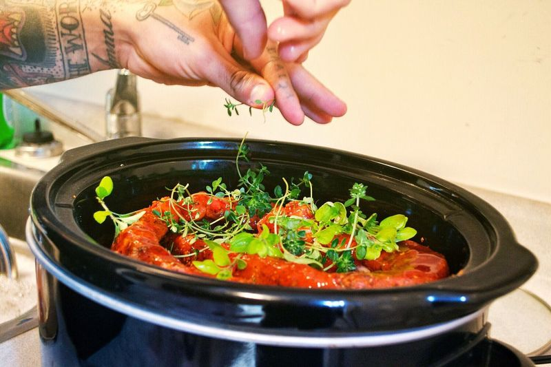 Cooking At Home Preparing Food Food Prep Cooking Herbs Cooking Dinner Cooking Ingredient Cooking Tools Slow Cooker Crock Pot Ribs Cooking Ribs Saucey Meat Mans Hands Tattooed Man Tattooed Hands Chef