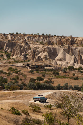 World best hot air balloon destination. Goreme, Turkey. Turkey Göreme Cappadocia Landscape Car Mode Of Transportation Scenics - Nature Environment Rock Motor Vehicle Nature Desert Rock - Object Transportation Land Day Arid Climate Climate Non-urban Scene No People Plant Solid Rock Formation Outdoors