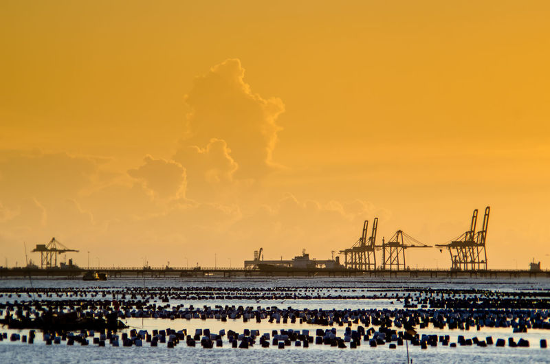 Seascape with deep port for shipping Bridge Cargo Cloud Cloud - Sky Cloudy Crane Crane - Construction Machinery Development Engineering Industry Jetty Nature No People Outdoors Port Sea Shipping  Sky Sunset Weather The Essence Of Summer