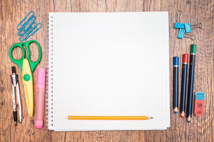Directly above shot of school supplies on wooden table