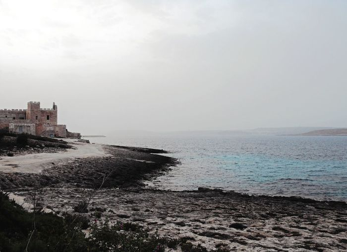 ... a splash of Blue ... Sea Travel Destinations Beach Water Scenics Architecture Horizon Over Water No People Malta Mediterranean  Ruins Ruined Building Exterior Built Structure Rocks Red Tower Outdoors Shores Travel Exploration Mysteries Twilight Adventure Fairytale