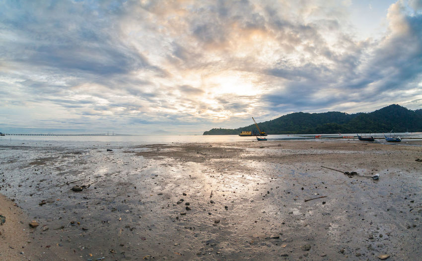 Mud texture with landscape view for background Sky Nature Water Scenics - Nature Tranquil Scene Cloud - Sky Tranquility Beauty In Nature Sea Beach Land Mountain Sand No People Day Idyllic Outdoors Non-urban Scene Nautical Vessel