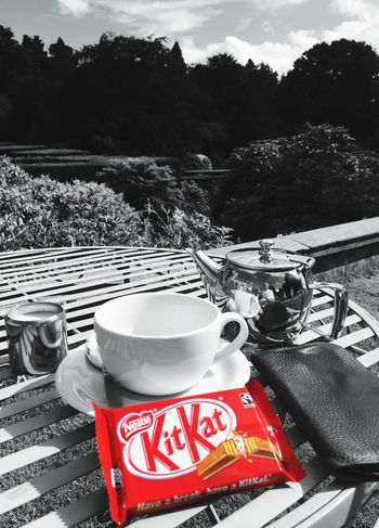 Step away from the KitKat! Food And Drink Refreshment In Front Of Beverage Tea Tea Time Chocolate Blackandwhite Colorsplash Black And White Black & White Blackandwhite Photography Black And White Photography IPhone Photography IPhone Iphonephotography IPhoneography My Smartphone Life Iphone6s Eye4photography  Black&white Blackandwhitephotography Outdoors Red Drink