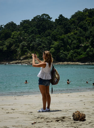 Manuel Antonio Manuel Antonio National Park Costa Rica 🇨🇷 Manuel Antonio Park Travel Beach Beauty In Nature Day Leisure Activity Lifestyles Nature One Person Outdoors People Real People Sand Sea Standing Tree Vacations Water Young Adult Young Women
