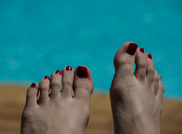 Close-Up Of Toes With Nail Varnish
