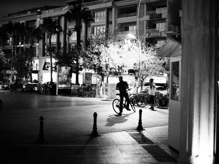 Night in Maramis II Black And White Monochrome Shallow Depth Of Field Black & White Blackandwhite Transportation Mode Of Transport Street Built Structure Architecture City Life City Road Men Car On The Move Building Exterior Bicycle Walking City Street Person Pedestrian Outdoors