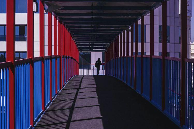 Full length of woman walking on footbridge