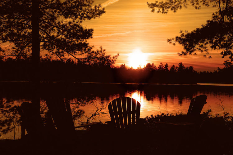 Another day comes to an end at the lake Adirondack Chairs Otty Lake Perth Sitting Pretty Summertime At The Cottage  At The Lake Cottage Tim Lake Lake View Lakeshore Lakeside Lakeside Beauty Reflections In The Water Sweet Memories Of Summer