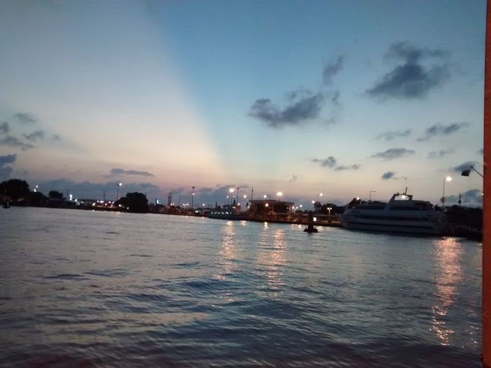 Sky Architecture Water Building Exterior Cloud - Sky No People City Nautical Vessel Built Structure Sunset Sea Dusk Outdoors Illuminated Waterfront Cityscape Skyscraper Nature Beauty In Nature Scenics