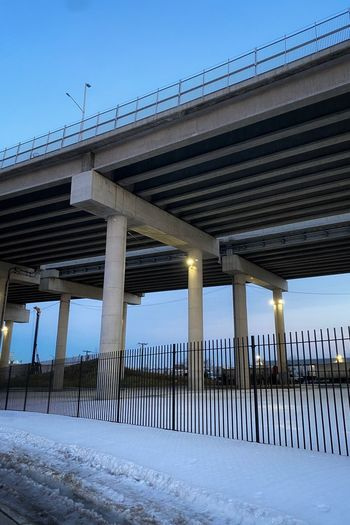 Low angle view of bridge against sky during winter