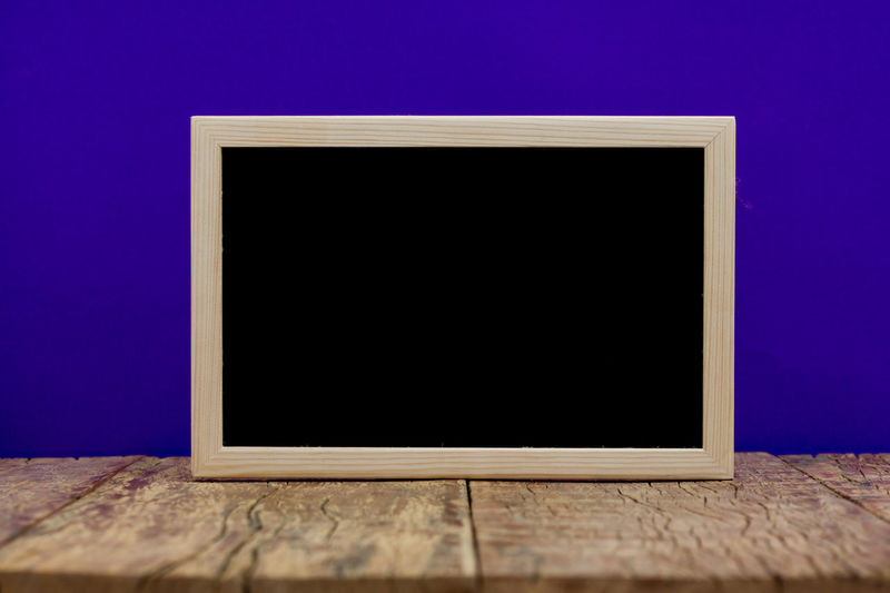 Blackboard School Halloween Black Color Blackboard  Blank Blue Close-up Copy Space Flat Screen Frame Indoors  Man Made Man Made Object No People Picture Frame Retro Styled Screen Single Object Table Technology Wood - Material