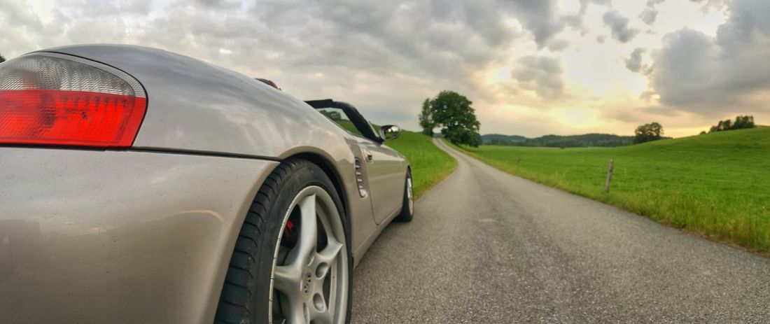 Car Wheel Cloud - Sky Motion Road Tire Rural Scene Sky No People Outdoors Day Sportscar Porsche Boxster S Sunset Live For The Story The Street Photographer - 2017 EyeEm Awards The Great Outdoors - 2017 EyeEm Awards Porsche Cabrio Cabriolet Let's Go. Together.