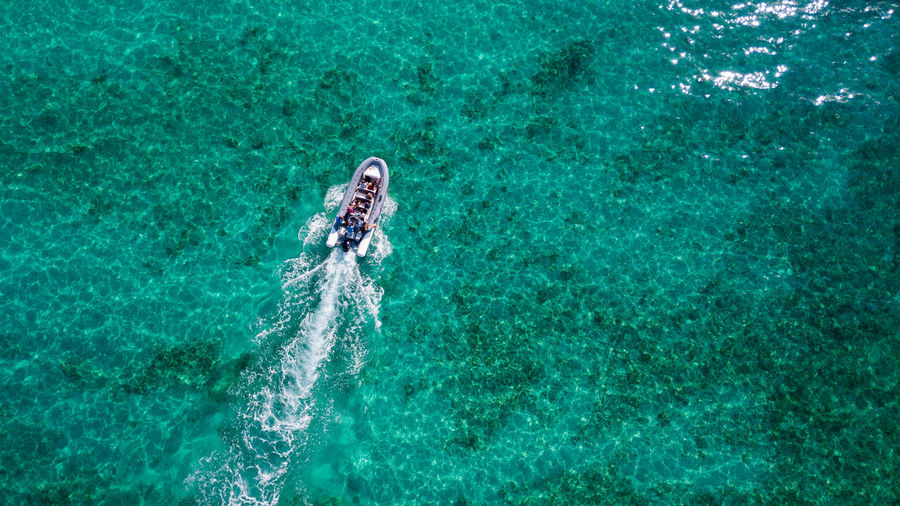Water Sport Leisure Activity Turquoise Colored High Angle View Sea One Person Lifestyles Motion Day Nature Real People Aquatic Sport Outdoors Waterfront Swimming Holiday Trip