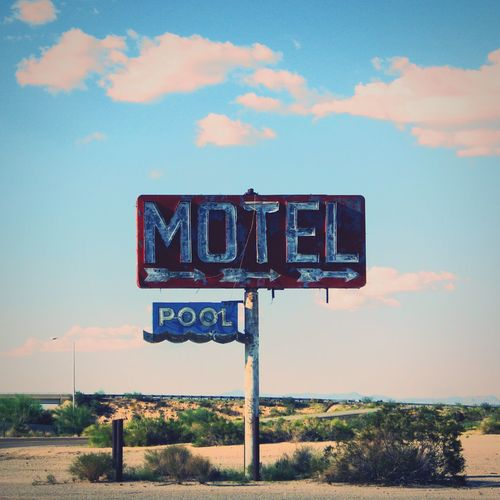 """""""Living the Pool Life [EyeEm Edition]"""" (09/2014) Pentax X-5 Wanderlust Vintage Abandoned Pool Motel Sign Sky Text Communication Cloud - Sky Outdoors Day No People Road Sign Guidance"""