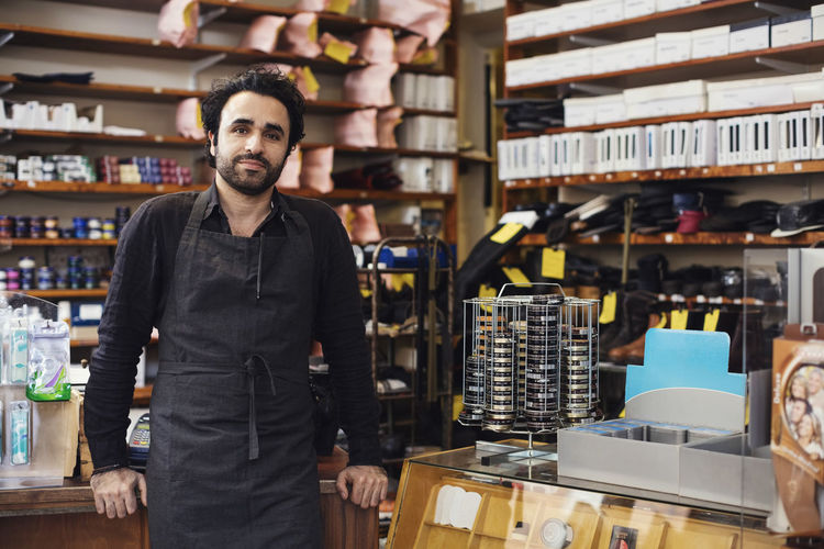 Portrait of man standing at store