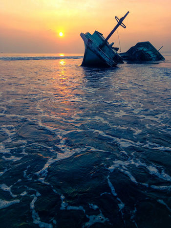 Nautical Vessel Sunset Sinking Damaged Sea Abandoned Accidents And Disasters Water Sunken Outdoors Transportation Beach Nature Floating On Water No People Crash Landscape Sky Cold Temperature UnderSea