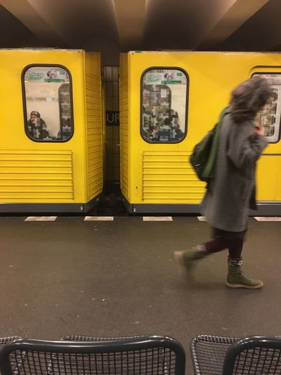 Full length of woman standing in train