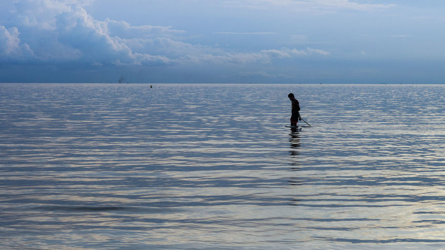 Side View Of Silhouette Man In Sea