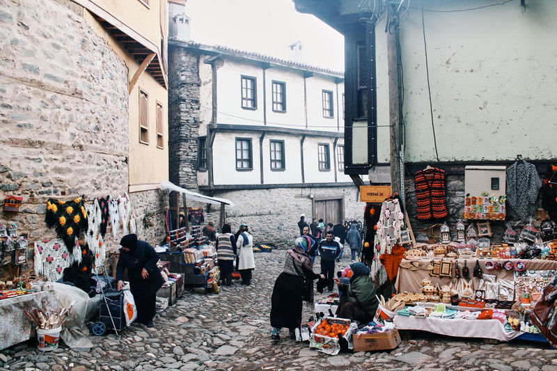 People at street market in city